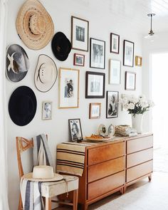 the Sonoma home belonging to @lauraresenphotography is up on the blog today and I don't know why I'm even bothering to try and pick a favorite detail because the whole thing is just so good. also HATS.  . . . photography via @onekingslane  #ckstyleaccordingly #gallerywall