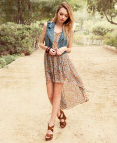 pretty and nicely layered. I love the high low skirt, showing off the legs.
