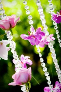 crystal bead strands...with floating flowers...of orchids, roses....etc..
