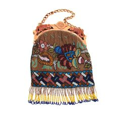 Early 1920's beaded purse with carved celluloid frame.