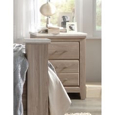 The Stonehill nightstand features a casual transitional character with its bold proportions, weathered wood finish and cool concrete textured tops.