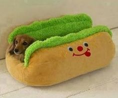Your little pooch will love snuggling up in this cozy hot dog pet bed! Suitable for small breeds such as dachshunds and toy poodles. It has ...