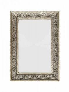Part of our White Metal range, the Tangier mirror has the versatility of being hung portrait or landscape above a mantelpiece. The solid nickel silver frame has been hand etched by our master craftsmen into a geometric, floral inspired design for a seamle Moroccan Furniture, Moroccan Lighting, Metal Mirror, Tangier, Oversized Mirror, Living Room, Handmade, Home Decor, Hand Made