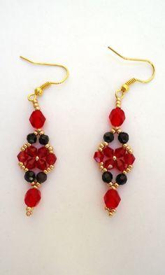 Beaded earrings in flower pattern with ruby by JoolsbyAveril
