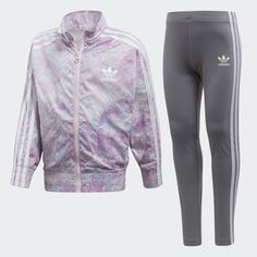 A sporty silhouette get a feminine update with batwing sleeves and an iridescent pastel foil print on the jacket of this modern set. This girls' track suit also has leggings that come in a polyester-blend jersey for a comfy fit. Shiny 3-Stripes flash adidas pride.