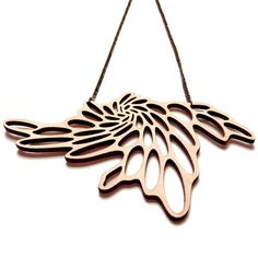This unique and lightweight wooden laser cut collier / necklace is inspired by random cell structures that occur at various levels in nature.