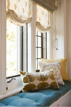 Love the layering of soft sheer shades and another roman shade in a lined room darkening fabric window seat | Elizabeth Dinkel