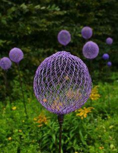 Funky garden art - purple chicken wire globes