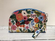 Fabulous Rifle Paper Co flower print fabric padded make up bag with a detachable wristlet. This is a substantial, padded bag with a zip, ideal for cosmetics. Padded Bag, Fox Fabric, Rifle Paper Co, Retro Floral, Cosmetic Pouch, Change Purse, Zipper Bags, Bridesmaid Gifts, Teacher Gifts