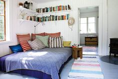 Love the bed in the corner with the book shelf above