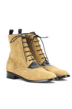 Balenciaga Suede Brogue Ankle Boots, $925; mytheresa.com