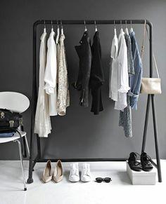 Minimalist Closet Design With A Black Frame And A White Chair A minimalist makeshift closet done with a black frame, a white chair and a box for shoes. Closet Minimalista, Chic Minimalista, Corner Wardrobe Closet, Wardrobe Rack, Closet Bedroom, Closet Space, Bedroom Inspo, Bedroom Decor, Minimalist Closet
