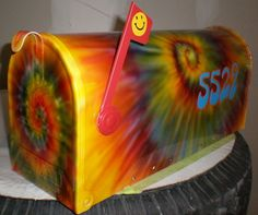 tye dyed mailbox~Very Cool...and it's a Standard mailbox, just dressed up with paint.