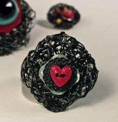 http://www.crochetconcupiscence.com/2012/01/recycled-vhs-tape-crochet-artist-adrian-kershaw/