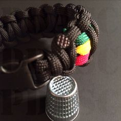 """I mentioned the other day that a thimble is a great alternative to using a lighter to mash your singes. Here's a close-up of the finish. The thimble makes a imprint in the molten nylon. It looks more """"finished"""" than the flat look made by the side of a lighter. #pdasc #paracord #gotparacord #paracordcommunity #technique #texture"""