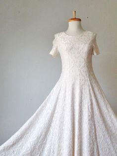 Vintage 60s Creme white Full Embroidery Maxi Princes Gored Dress. $59,99, via Etsy.