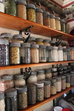 Beautiful open shelf pantry... and I like the idea of everything in a mason jar... it makes me happy.