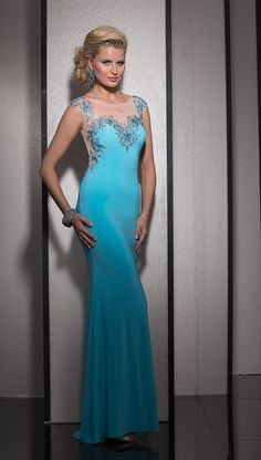 Clarisse 2603 is an elegant modern knit prom dress with a sheer illusion neckline and sheer back.
