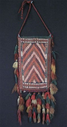 Turkmenistan Yomud igsalyk. Circa: 1930 – 1940 Size: 8″ x 14.5 – 17.5″ (21cm x 37 – 57cm) Turkmenistan Yomud igsalyk – spindle bag. Great original condition. Backing woven mostly with camel hair.