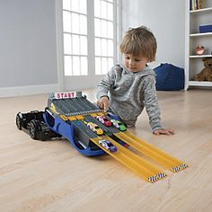 "Car Case Play Set with Toy Cars and Race Track: A racecar, race track, and carry in case, in one remarkable 3-in-1 toy! As if this 17""L freewheeling car wasn't already big fun, it transforms into a racetrack for diecast model cars. Lift the gate, and watch 'em speed down the ramp! Plus, it's also a handy car storage case that neatly holds 24 diecast cars (we're including four cars to start your collection)..."