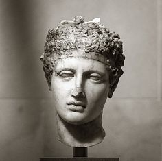 138-192. marble head of an Athlete, wearing a fillet around his tightly curled locks. roman copy of ca. 450 BCE Greek bronze statute, The contrast of smooth polished flesh against the deeply drilled hair was a Roman aesthetic. Mid-Imperial, Antonine,