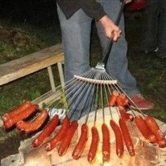DUUUDE! If you know me, we are totally cooking these over the new in ground fire pit at my place!  Come over!     Hot Dogs + Rake = Genius