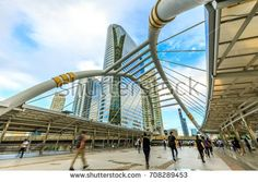 People walking at Chong Nonsi skywalk in the morning to go to work, Business district with high building. Bridge link between mrt and bts mass transportation in heart of Bangkok, Thailand