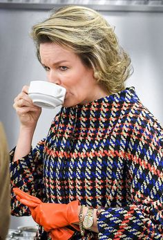 Queen Mathilde of Belgium, who was spotted on a busy day of engagements wearing a Natan checked belted coat and found time for a hot drink during her very busy day in the province Flemish Brabant