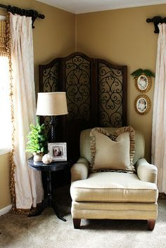Great use of screen in corner to make a cozy focal point.       The Butlers: Holiday Home Tour