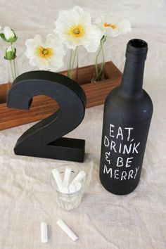 Create a fun, rustic centerpiece using old bottles and chalkboard paint. Don't forget the chalk so your guests can leave you notes! (Old Bottle Centerpieces) Chalkboard Table, Blackboard Paint, Chalkboard Ideas, Chalk Paint, Bottle Centerpieces, Wedding Centerpieces, Wine And Cheese Party, Do It Yourself Wedding, Bottle Painting