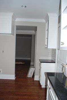 No - too brown  Sherwin Williams Agreeable Gray  Love the wall color with the floors