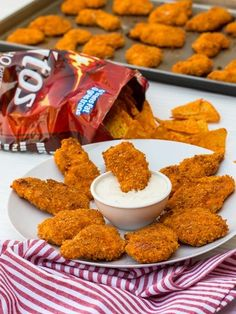Doritos Crusted Chicken Fingers - Marinate sliced boneless chicken breasts in buttermilk for 2 hours. Dredge in flour. Dip in egg wash. Dredge in crushed Doritos. Bake in a 400F for 15-20 minutes.