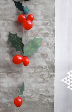 DIY balloon and construction paper holly.