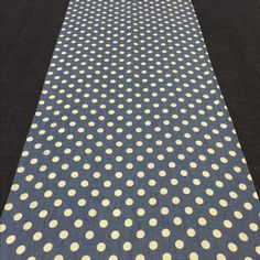 Dark denim cloth with a denim polka dot runner