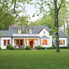 Charming Home Exteriors (via Southern Living. #3 Picturesque Tennessee Farmhouse. (Some ideas for cheering up our place here ... in this instance the porch with ballustrade above)