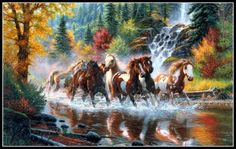 This photograph of the horses running through the water with all the colorful trees in the background is stunning. Click on pin for Pinterest tips.