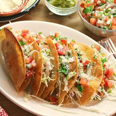 """Make your next taco night """"muy bueno"""" with this creative Vegetarian Crispy Potato Tacos recipe. Colorado ain't done yet, add some hatch green chilies to that mini mountain of crispy potatoes. Hold the cheese and sour cream but they look so yum! Mexican Dishes, Mexican Food Recipes, Vegetarian Recipes, Dinner Recipes, Cooking Recipes, Snack Recipes, Healthy Recipes, Potato Tacos, Comida Latina"""