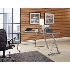 Create an instant workspace with this glass and metal computer desk. With its L-shaped design, this desk takes advantage of even small spaces. The dark gray finish of the durable metal frame allows this desk to work well with any modern decor.