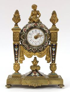 French gilt bronze and champleve enamel decorated carriage clock