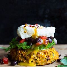 Oven baked sweet potato rösti with black bean salsa, avocado and poached egg