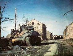 A destroyed Sherman tank, in France. -