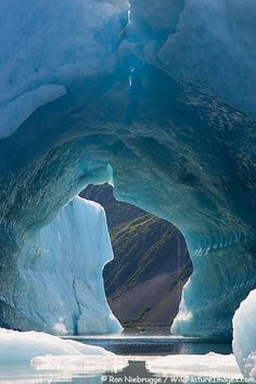 ✯ Kayaking among icebergs in Bear Lagoon, Kenai Fjords National Park, near Seward, Alaska. How big that ice tunnel is . Look at the tiny kayak! Alaska Travel, Travel Usa, Alaska Cruise, Alaska Trip, Alaska Usa, Places To Travel, Places To See, Places Around The World, Around The Worlds