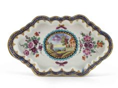 A Worcester spoon tray c.1780, decorated in the Dalhousie manner with a central landscape panel within floral arrangements and flying moths, the rim with a blue and gilt border, open crescent mark, 16cm.