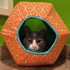 """An Etsy customer sent us this convo after receiving her Cat Ball®cat bed: """"We got the cat ball today and let me tell you, it's way cuter than the cardboard box I had for her to use. I think she loves it!!! THANKS!!!"""""""