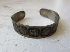 Your place to buy and sell all things handmade 1970s Bands, Black Enamel, Horoscopes, Zodiac Signs, Cuff Bracelets, Etsy, Vintage, Jewelry, Jewlery