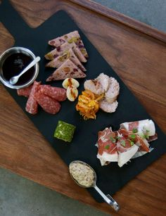 """""""Even something as routine as a charcuterie platter turns into a brilliant array of firm house-made fennel salami, a coarse pistachio-and-prune pork pate, and a hedonistic chicken-liver-and-port-wine spread, accompanied by a pungent kimchi with coriander and curry."""" ~ Pat Sharpe, Texas Monthly"""
