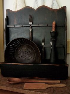 This once was an old spoon rack that you see at the junk stores all the time for cheap.PRIM it up, black paint add your old dodads and VOILA!!! A little work & a little paint CHEAP & EASY !!! Got to luv the Junk Stores.