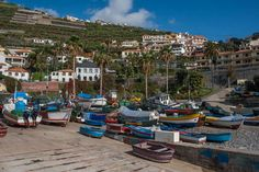 We visited Camara de Lobos, a fishing village on a beautiful sunny day. The bright fishing boats and the smells from the kitchens are divine Places Around The World, Around The Worlds, I Want To Travel, Fishing Villages, Fishing Boats, Sunny Days, Portugal, Street View, Kitchens