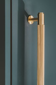 Brass cabinet handle - A stunning knurled brass handle from www.busterandpunc… on a Fenix faced Husk kitchen cabinet -