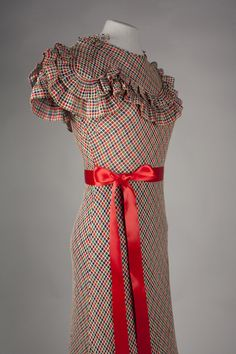 Accession Number: 2001.104.102 Date Made: 1932 Description: Dress; red, blue, and green check on a white windowpane-ground cotton, bias-cut with tiered ruffles at bodice and knee. Dress is narrowly hemmed.